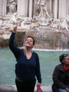 Tossing a coin into the Trevi fountain, ensuring my return to Italy!